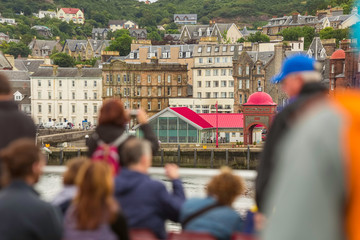Ferry Tourists on a Looking Towards Oban Scotland