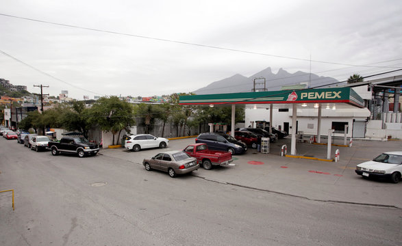 Cars line-up to buy fuel at a gas station in Monterrey