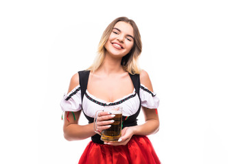 Young sexy woman wearing a dirndl with beer mug over white background