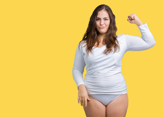 Beautiful plus size young overwight woman wearing white underwear over isolated background Strong person showing arm muscle, confident and proud of power