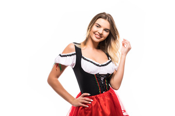 Beautiful woman in a traditional bavarian dirndl isolated on white background