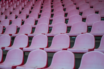 Red seats in the stadium. Empty seat of football stadium