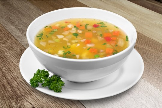 Vegetable soup isolated on a white background