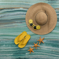summer color beach straw hat isolated on sea background