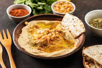 Classic Hummus with chickpeas, paprika, olive oil and oriental spices. Mediterranean popular snack of chickpeas and tahini pasta.