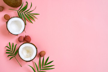 Pink tropical background with coconut and palm leaves