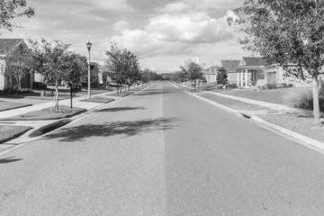 View on the street in a small city black and white photo