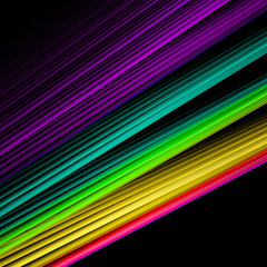 Abstract background with rainbow lines on black