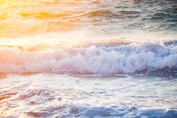 beautiful sea waves at sunset -  beach holiday background