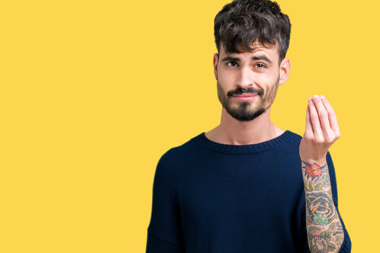 Young handsome man over isolated background Doing Italian gesture with hand and fingers confident expression