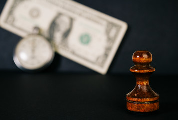 Chess, watches and a banknote. Concept 'time is money'.