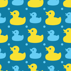 Seamless pattern with yellow rubber ducks on a blue background