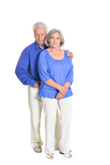 portrait of senior couple hugging on white background