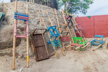 Bamboo chairs used for carrying people at Mt Kyaiktiyo (Golden Rock), Myanmar