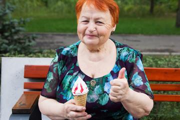 elderly female happy old woman eating ice cream