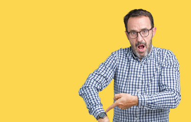 Handsome middle age elegant senior man wearing glasses over isolated background In hurry pointing to watch time, impatience, upset and angry for deadline delay