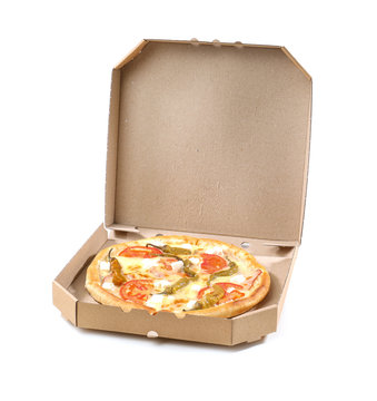 Open cardboard box with delicious pizza on white background. Food delivery