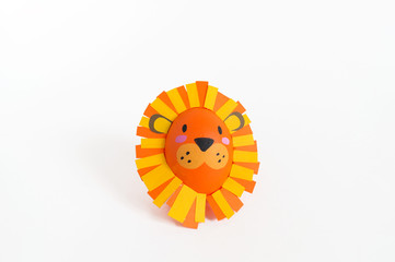 Easter holiday concept with cute handmade eggs: a lion.
