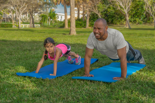 Father and daughter exercise together in the mornings.