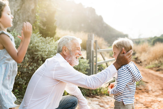Grandfather and grandson playing outdoors