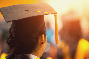 Soft focus rear view of the university graduates line up foe diploma award in the university graduation ceremony