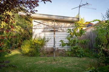An old Hills Hoist in a Victorian back yard at sundown