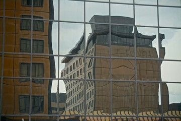 Anchorage, Alaska, USA: A building with a striped awning reflected in the glass facade of another building.