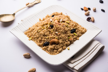 Semolina Halwa / Sooji ka Halva or sweet Rava Sheera or shira - Indian festival sweet made of semolina, nuts and Ghee