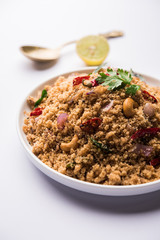 Rava Upma / Uppuma - south indian breakfast served in a bowl. selective focus