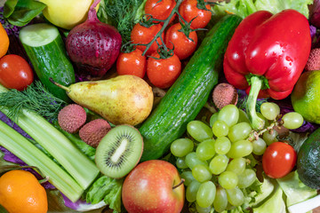 Different raw vegetables and fruits background.