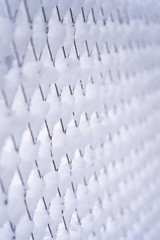 wire mesh grid covered by snow