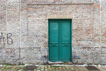 old wooden door in brick wall