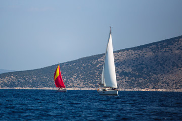 Wall Mural - Sailing luxury boats participate in yacht regatta in the Aegean Sea in Greece.