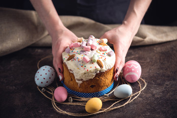 Card with traditional desserts and colorful eggs in rustic style on a dark background. Happy Easter