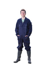 Studio cut out of farmer in overalls on white background smiling at camera