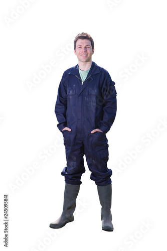 Studio cut out of farmer in overalls on white background