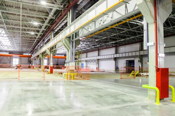 large room with concrete floor at the factory