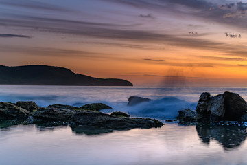 Soft Streaky High Cloud Dawn Seascape with Rocks