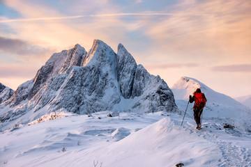 Mountaineer man climbs on top snowy mountain Wall mural