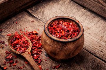 Spoed Foto op Canvas Kruiderij Seasoning pepper sweet, red, sliced.