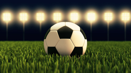 Soccer ball - illuminated football stadium