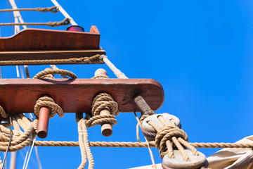 Vintage Sailboat Rigging / Jacobs ladder made of ropes at old sailing ship on nostalgic cruise, blue sky background (copy space)