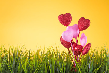 a grass and hearts abstract background