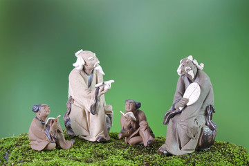 Learn China / Learn Chinese language concepts : Antique clay sculptures of Confucius with students...
