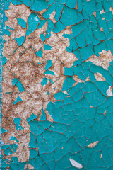 cracked blue paint on a wooden surface
