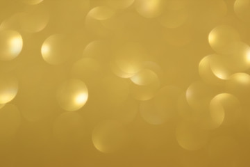Golden defocused flickering lights for text and background