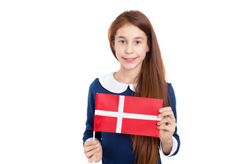 Portrait of a girl with the flag of Denmark, isolated on white background.