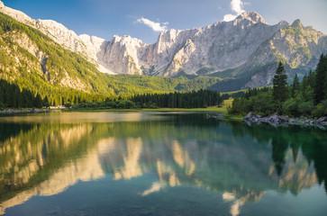Fototapete - Superior Fusine Lake with Mount Mangart on the background. Fusine Lakes Natural Park, Tarvisio, Udine province, Friuli Venezia Giulia, Italy.