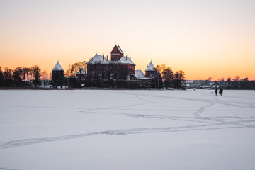 Trakai island castle in winter time with sunset sky. Trakai, Lithuania.