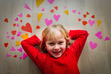 happy cute little girl play with hearts from paper, valentine day